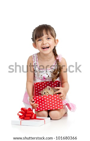 happy child girl holding gift box with kitten - stock photo