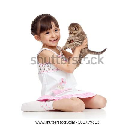 happy child girl holding  kitten