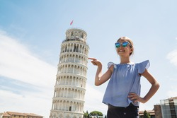 Happy child girl pointing Leaning Tower of Pisa