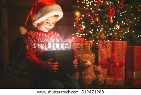 happy child girl with a magic Christmas gift