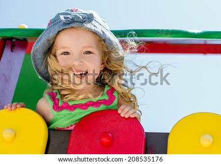 happy child having fun on the playground stock photo