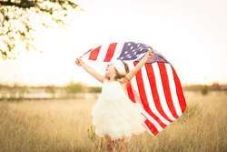 Happy child holds american flag