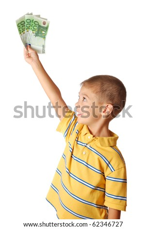 Happy child holds money in hand isolated on white background