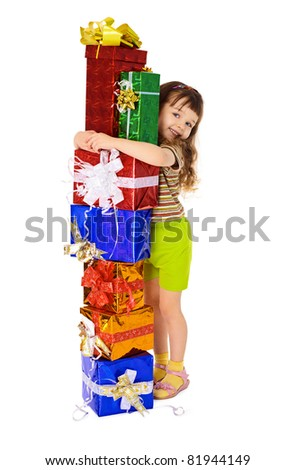 Happy child hugs gifts in boxes