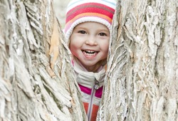 happy child in a park in the striped hat