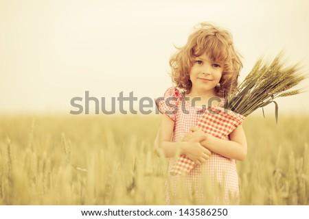 happy child in autumn wheat...