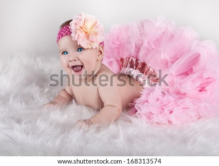 Happy child in lush pink skirt