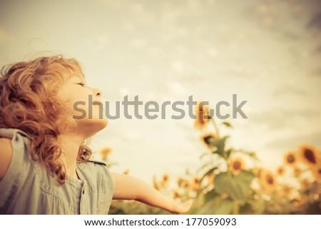 happy child in sunflower field. ...