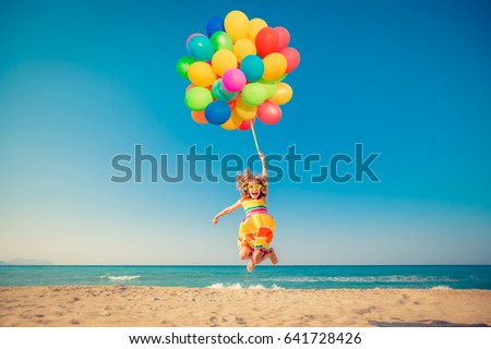 happy child jumping with...