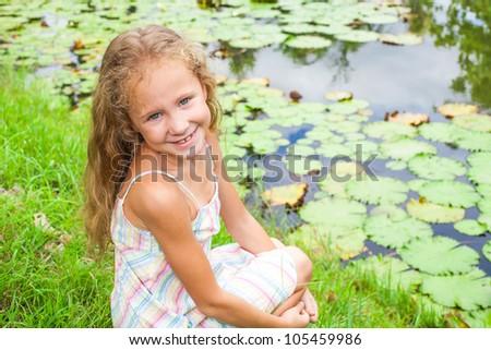 happy child near a pond #105459986