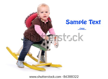 Happy child on a rocking horse with space for your text.