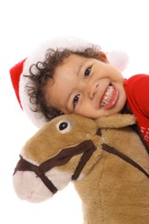 happy child on pony upclose