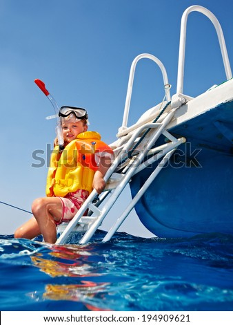 Happy  child on yacht. Snorkeling travel.