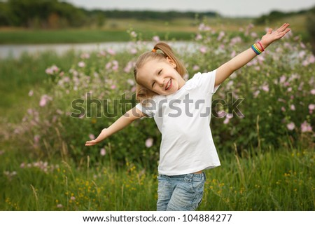 Happy child outdoors with outstretched arms