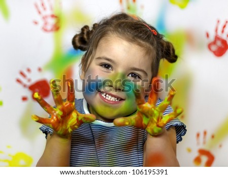 Happy child plays in the paint at home during the renovation