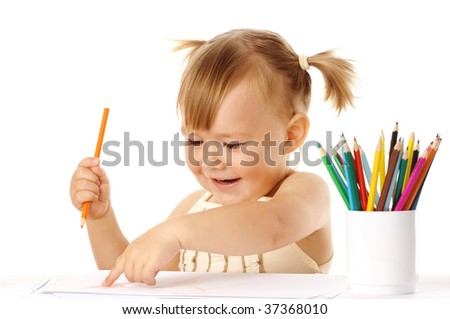 Happy child points on her drawing and smile, isolated over white