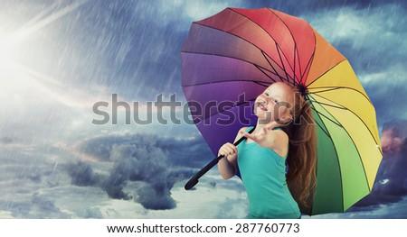 Happy child with a colorful umbrella
