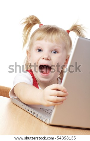 happy child with a loptop in hands - stock photo