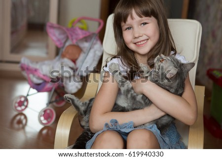Happy child with cat at the home.  #619940330