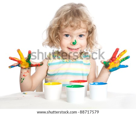 Happy child with fingers paint