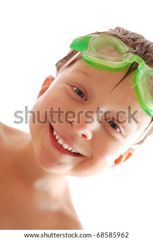 happy child with goggles over white background