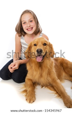 Happy child with her golden retriever dog