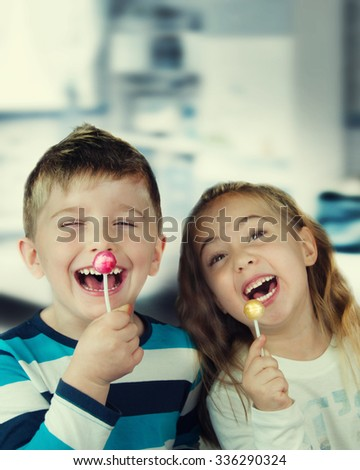 Happy child with lollipop.