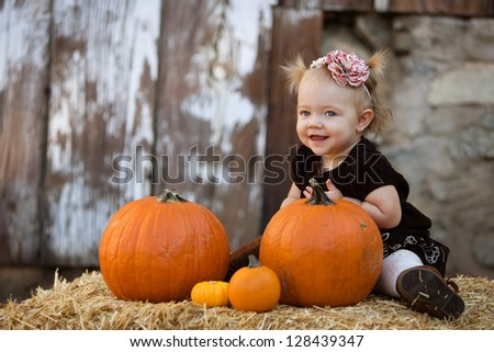 happy child with pumpkins