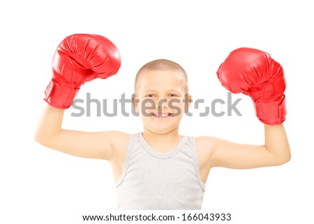 Happy child with red boxing gloves gesturing triumph isolated on white background