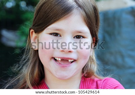 happy child with smile and changing teeth