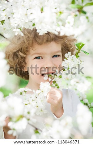 Happy child with spring flower. Ecology concept