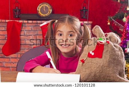 happy child writes letter to Santa Claus