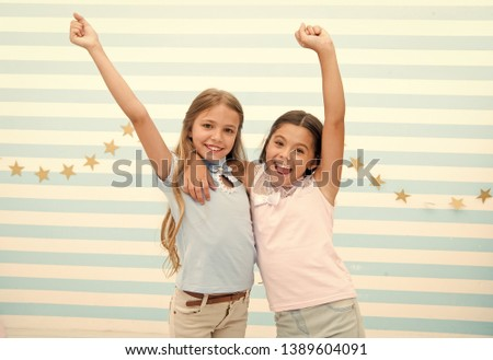 happy childhood. happy childhood of little girls with raised hands. little girls smiling