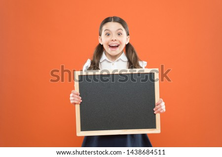 happy childhood. school market sales. signage. cheerful school girl with blackboard. happy pupil in school uniform. copy space. commercial marketing conept. business school advert. new shopping idea.