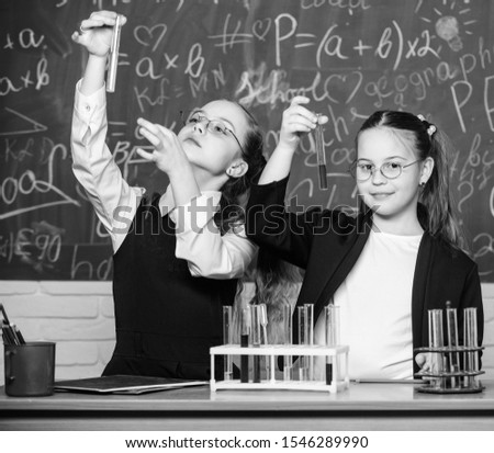 Happy children. Biology lesson. students doing biology experiments with microscope in lab. Biology equipment. biology education. Little kids learning chemistry in school laboratory. Scientist at work.