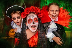 Happy children celebrate Halloween on a party with old castle decorations. Halloween.