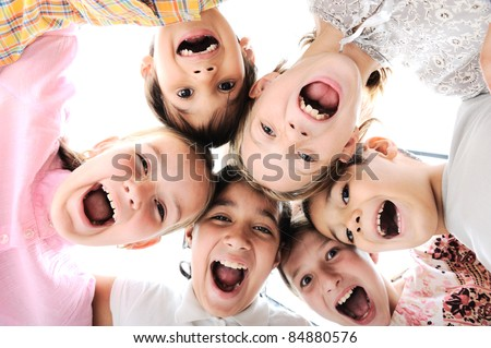 Happy children embracing each other and smiling at camera