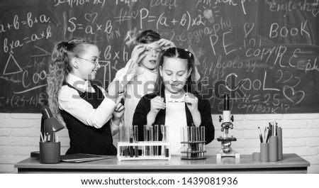 Happy children friendship. Teamwork. students doing science experiments with microscope in lab. Biology equipment. Little kids learning chemistry in school laboratory. Where little things mean a lot.