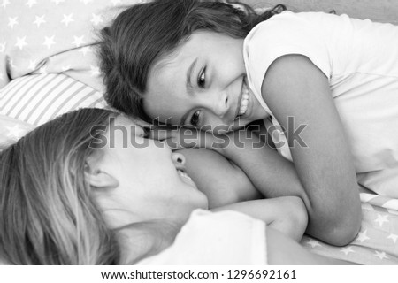 happy children. happy children day with two little girls. little girls smiling in bed. family concept.