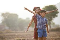 Happy children having fun in agricultural field