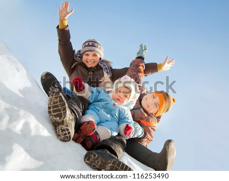 Happy children having fun in the snow