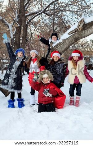 Happy children having fun outdoor on winter.