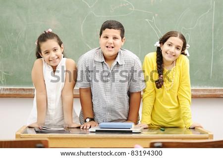 Happy children in classroom, school