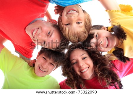 Happy children in family circle smiling.