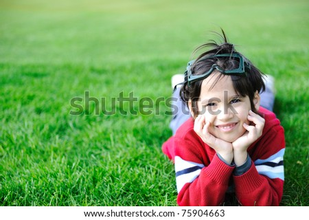 Happy children in grass - stock photo