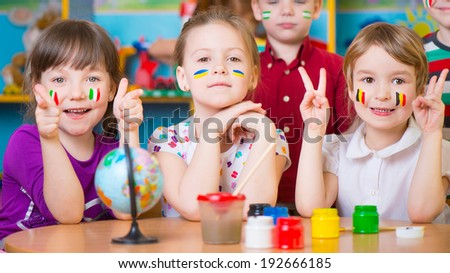 Happy children in language camp studying geography