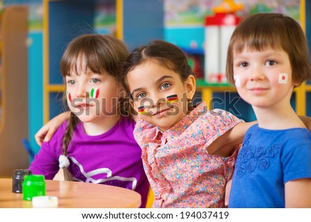 ShutterStock Happy children in language camp studying geography ...