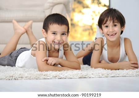 Happy children in living room at home