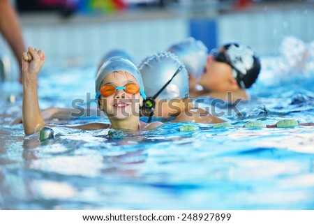 happy children kids group at swimming pool class learning to swim #248927899