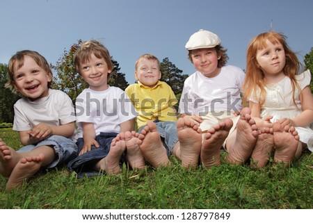 happy children on grass outdoors